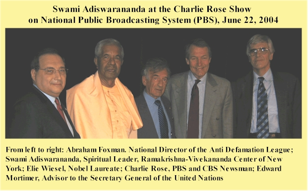 Swami Adiswarananda at the Charlie Rose Show with other speakers.